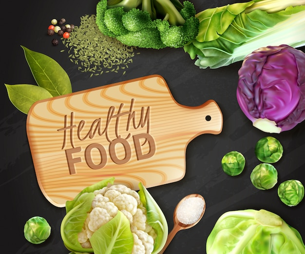 Realistic vegetables background with wooden cutting board and various kinds of cabbage