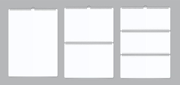 Realistic wall calendars. notebook bind paper calendar with iron spiral. vector illustration empty white realistic mockup