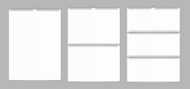 リアルな壁掛けカレンダー。ノートブックは、鉄のスパイラルで紙のカレンダーをバインドします。ベクトルイラスト空の白いリアルなモックアップ