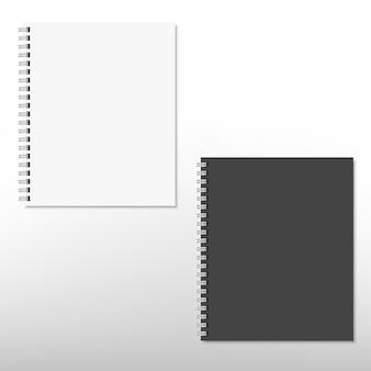 Реалистичный белый и черный спиральный блокнот, изолированный на белом. .