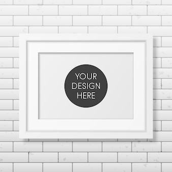 Realistic white frame a4 on the brick wall