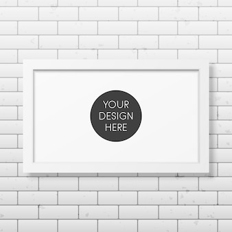 Realistic white frame on the brick wall