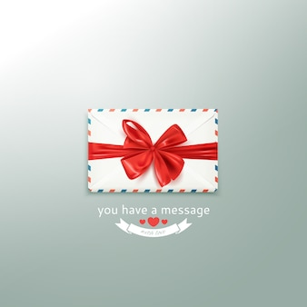 Realistic white vintage envelope with decorative red bow