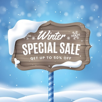 Realistic winter sale ad on sign