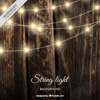 Realistic wooden background with string lights