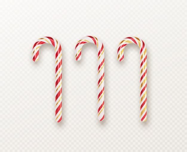 白い背景に分離された現実的なクリスマスキャンデー杖セット。