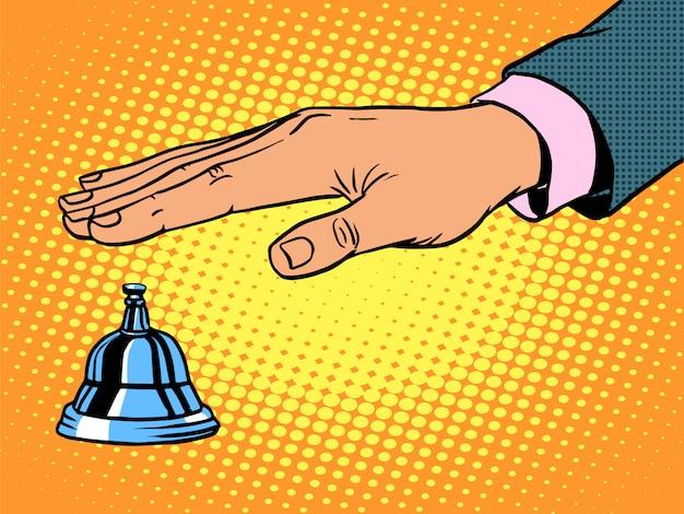 Reception desk call bell hand