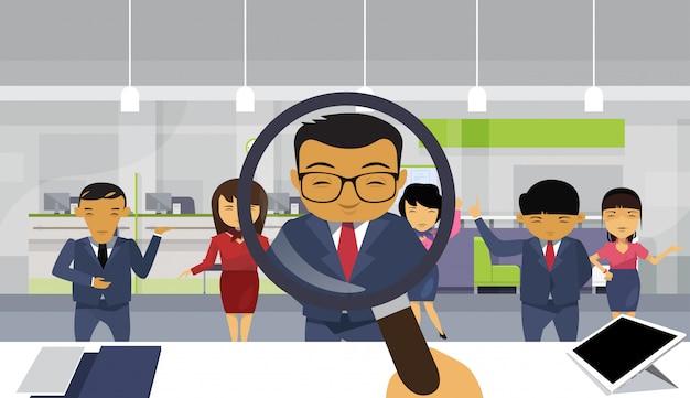 Recruitment hand hold magnifying glass choosing businessman
