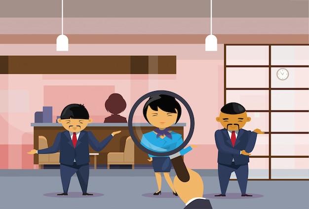 Recruitment hand hold magnifying glass choosing businesswoman