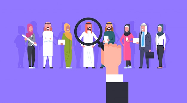 Recruitment hand zoom magnifying glass picking business person candidate from arab people group