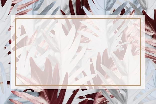 金属の葉のパターン化された背景の長方形フレーム