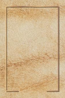 Прямоугольная золотая рамка на коричневом кожаном фоне