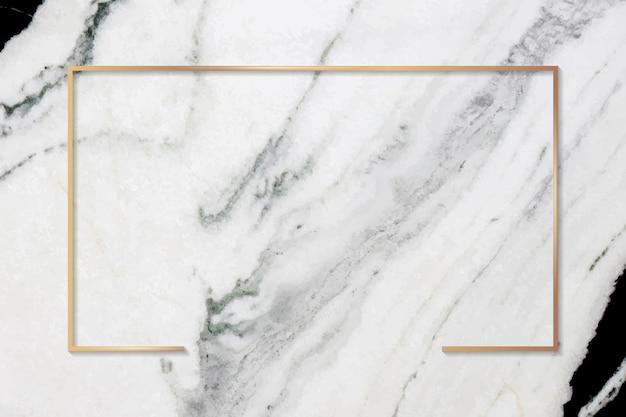 Прямоугольная золотая рамка на сером мраморном фоне