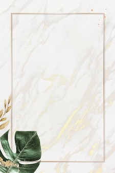 Rectangle gold frame with monstera leaf background vector
