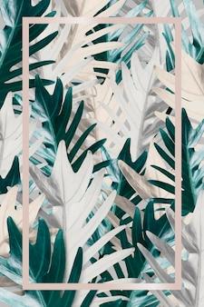 金属のヤシの葉のパターンの背景に長方形のピンクゴールドフレーム