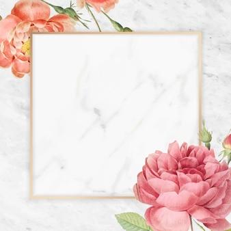 大理石の背景に長方形のバラのフレーム