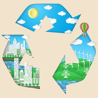 Recycling symbol with green eco city, solar panels, windmills, blue sky with sun and light white clouds.