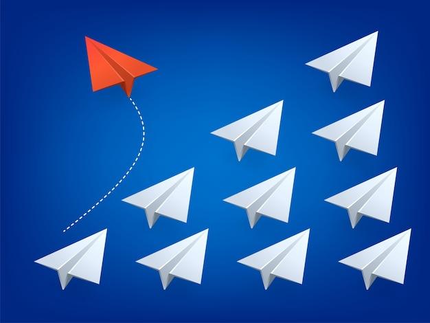 赤い飛行機が方向を変え、白い飛行機。新しいアイデア、変化、トレンド、勇気、創造的なソリューション、革新、そしてユニークな方法のコンセプト。図