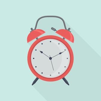 赤い目覚まし時計。目を覚ます時間