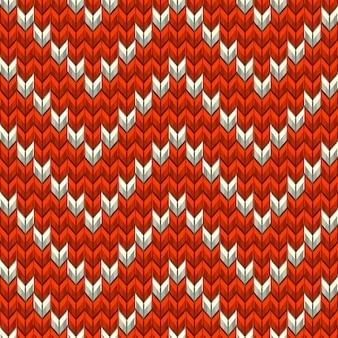 Красно-бежевая вязанная зигзагообразная текстура.