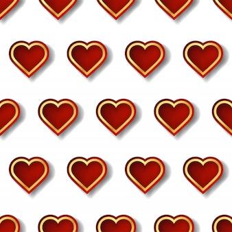 幾何学的なスタイルの創造的な形をした赤と金の心のパターン。