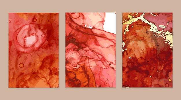 Абстрактные текстуры красного и золотого мрамора в технике спиртовой туши