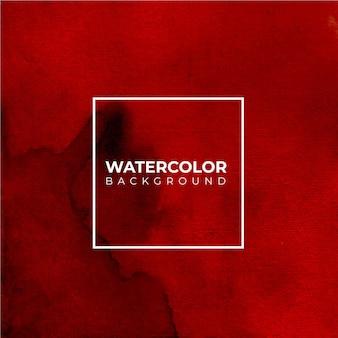 赤とオラーニュの水彩テクスチャ背景、ハンドペイント。白い紙の上にはねかける色