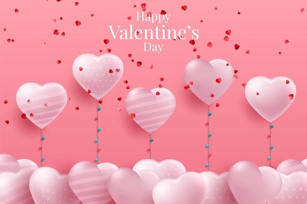 Красные и розовые воздушные шары в форме сердца на розовом фоне на день святого валентина