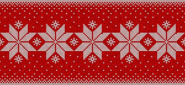 雪片と赤と白のクリスマスのシームレスなパターン