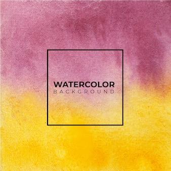 赤と黄色の抽象的な水彩画の背景、紙の上にはねかける色