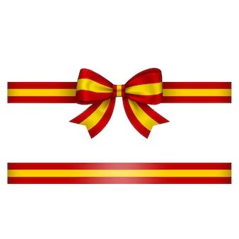 빨간색과 노란색 스페인 활과 리본