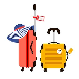 赤と黄色の旅行スーツケースのイラスト