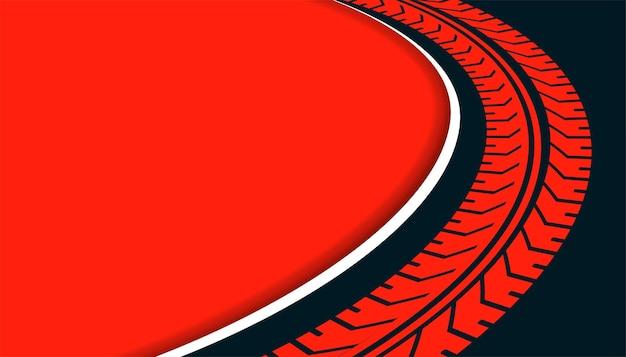 Sfondo rosso con stampa della ruota della traccia del pneumatico