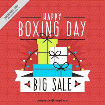 いくつかの贈り物ボクシングの日の赤い背景