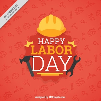 Red background of labor day with helmet and tools