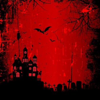 Red background with a haunted house for halloween
