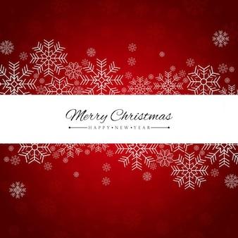 メリークリスマス雪片と赤の背景