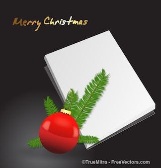 Palla rossa di natale e una scheda in bianco