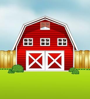 緑と空の背景に赤い納屋の漫画スタイル