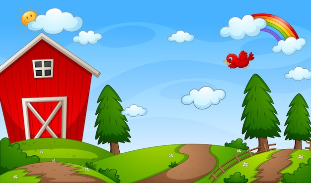 Red barn farm in nature scene with rainbow in the sky