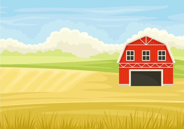 Красный сарай с открытыми воротами в поле.