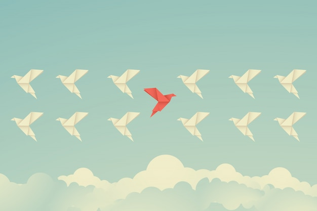 Red bird changing direction. new idea concept