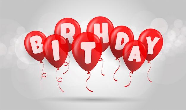 Красные воздушные шары дня рождения, день рождения написанный на красных воздушных шарах на предпосылке bokeh.
