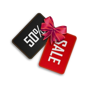 Red and black tag discount with red bow.