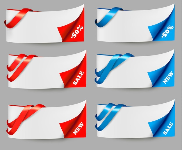 Red and blue sale banners with ribbons.