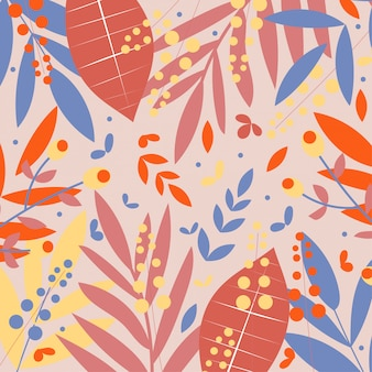 Red, blue and yellow tropical leaves on beige background