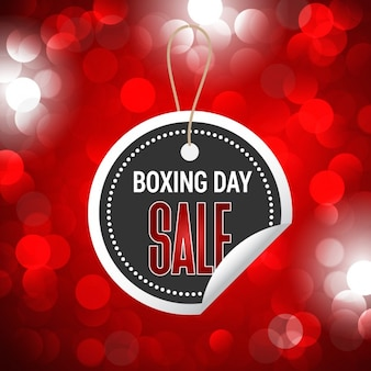 Red bokeh background with boxing day sticker