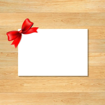 Red bow and blank gift tag with wooden wallpaper, with gradient mesh