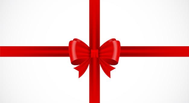 白い背景の上の赤いリボンリボン赤い弓ギフトパッケージ分離