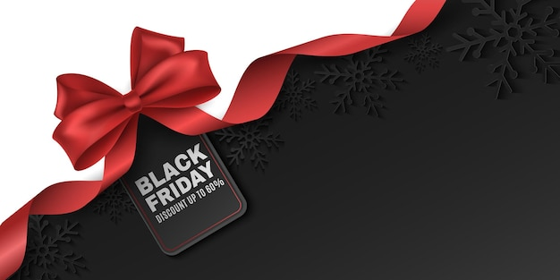 Red bow and ribbon with tag for black friday sale. vector label to advertise your business promotions. commercial discount event. paper snowflakes on a dark background. eps 10.